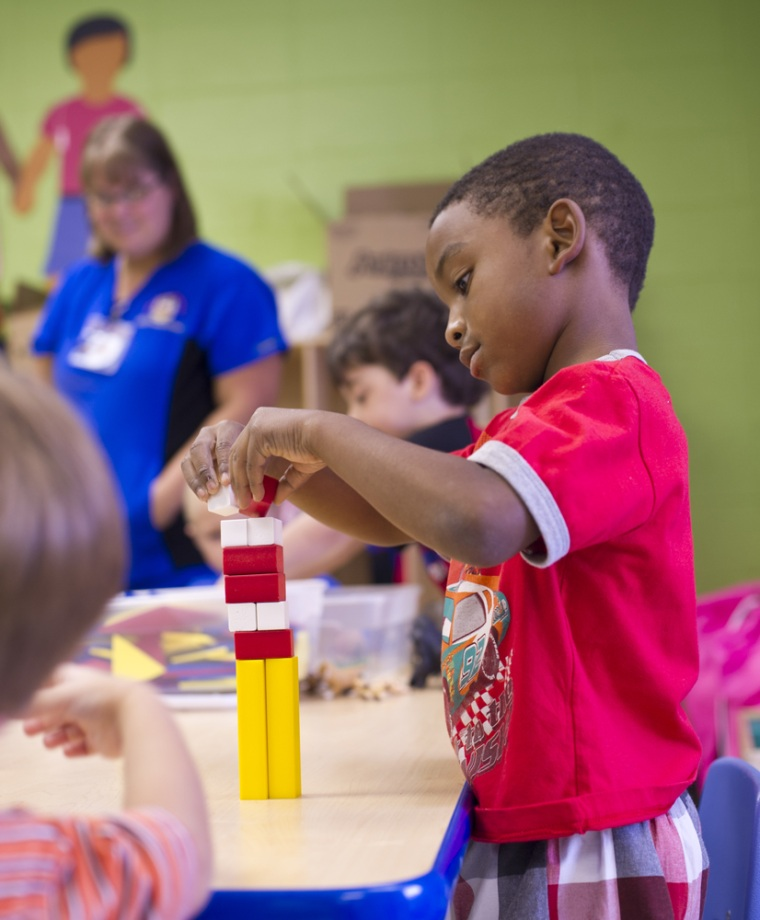 A child in a Monroe County pre-kindergarten center uses one of the many educational games and toys provided by the Gilmore Foundation.