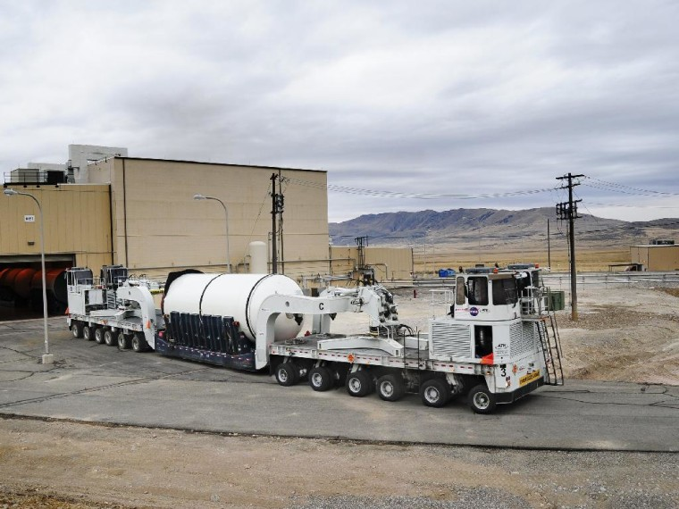 The forward segment of the qualification motor for NASA'S Space Launch System rocket is transported through manufacturing and assembly at ATK's facility in Promontory, Utah in preparation for a full-scale ground test there in the spring of 2013.