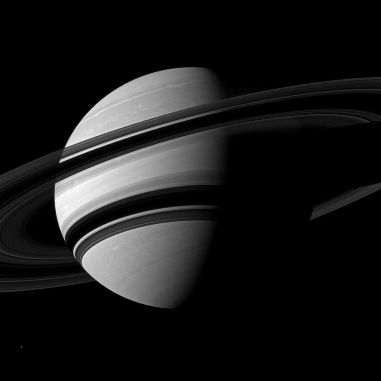NASA's Cassini spacecraft snapped this angled shot of Saturn, showing the southern reaches of the planet with the rings on a dramatic diagonal. Saturn's icy moon Enceladus is visible as a tiny white speck in the lower lefthand corner. The picture was taken on June 15 at a distance of about 1.8 million miles.