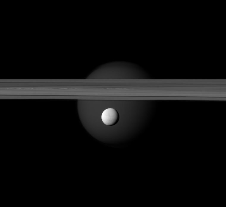 Image:Saturn's Enceladus hangs below the gas giant's rings while Titan lurks in the background.
