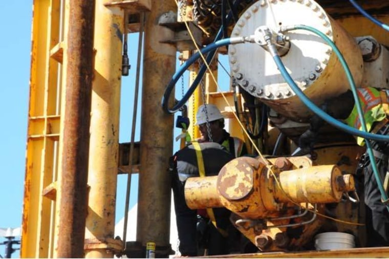 This photo of a Transocean employee working on the failed BP blowout preventer was among the evidence submitted by the U.S. Chemical Safety Board.