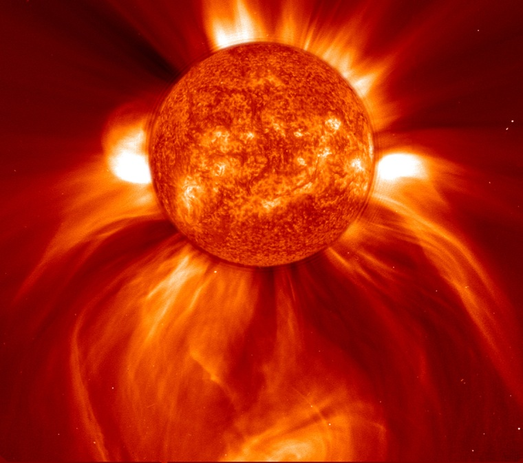 Charged particles ejected with this coronal mass ejection (pointing down) can create a potentially dangerous environment for astronauts in space.