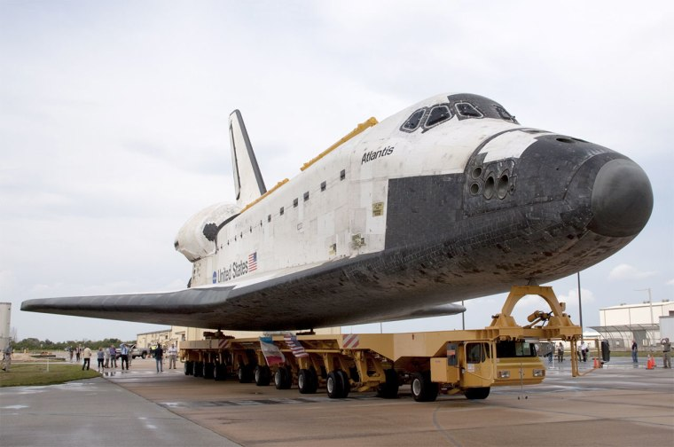 Space shuttle Atlantis moves on the Orbiter Transporter System (OTS) at NASA's Kennedy Space Center in Florida. The same OTS will be used to deliver Atlantis to the Kennedy Space Center Visitor Complex on Nov. 2.