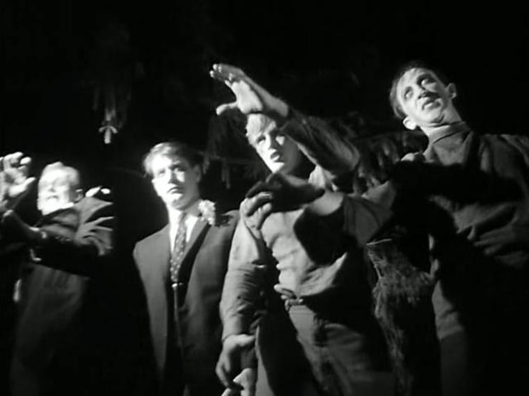 """Zombies on the march in a scene from """"Night of the Living Dead,"""" George Romero's 1968 film."""