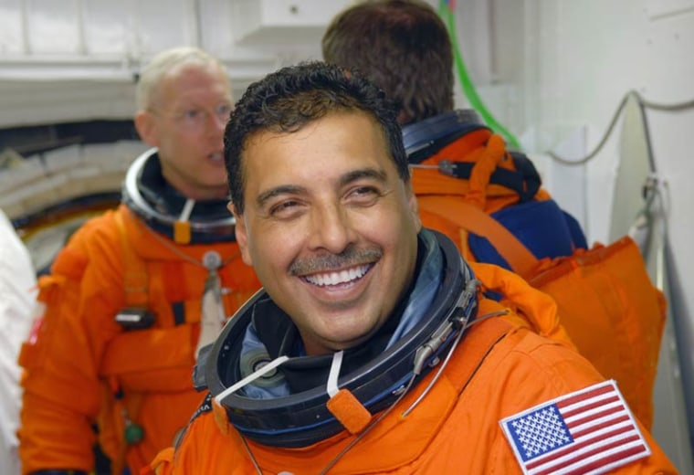 In the White Room on NASA Kennedy Space Center's Launch Pad 39A, STS-128 Mission Specialist Jose Hernandez — a former migrant farmer from Stockton, Calif.— waits to enter space shuttle Discovery during a rehearsal for his Aug. 25, 2009 launch.