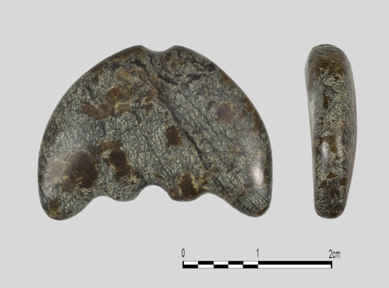 Two views of a sickle moon carved from serpentinite found in the Belica hoard.