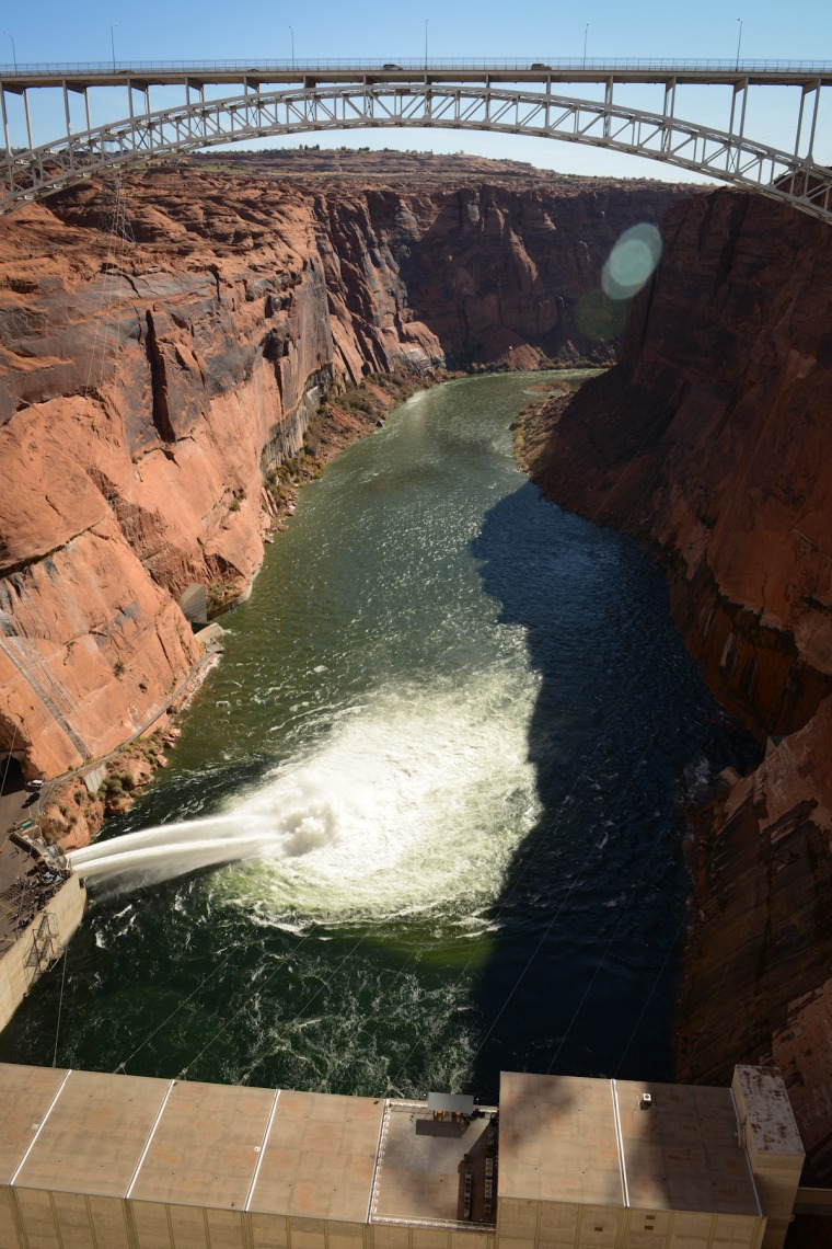 Bypass tubes gushing Colorado River water on Mondayduring a high-flow release at Glen Canyon Dam, the first step in an ongoing experiment to rebuild beaches and fish habitat in the Grand Canyon.