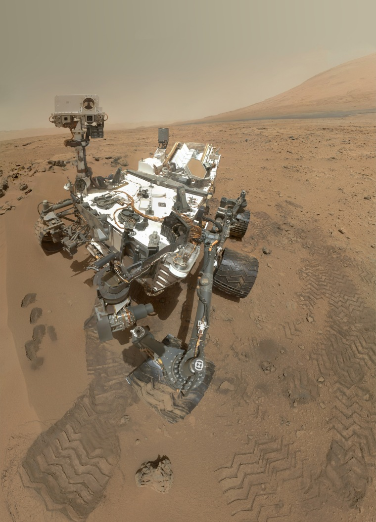 NASA's Mars rover Curiosity used its Mars Hand Lens Imager (MAHLI) to snap a set of 55 high-resolution images on Oct. 31. Researchers stitched the pictures together to create this full-color self-portrait.