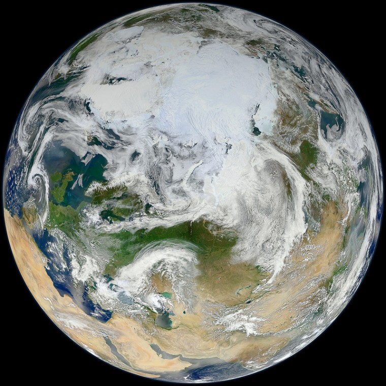 """The """"blue marble"""" of Earth gets a makeover in this view of the Arctic as seen by the Suomi NPP satellite. The image was released on June 18."""
