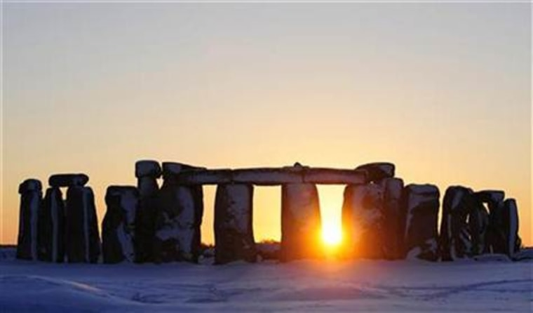 The sun sets behind Stonehenge in Wiltshire, southern England on Jan. 7, 2010.
