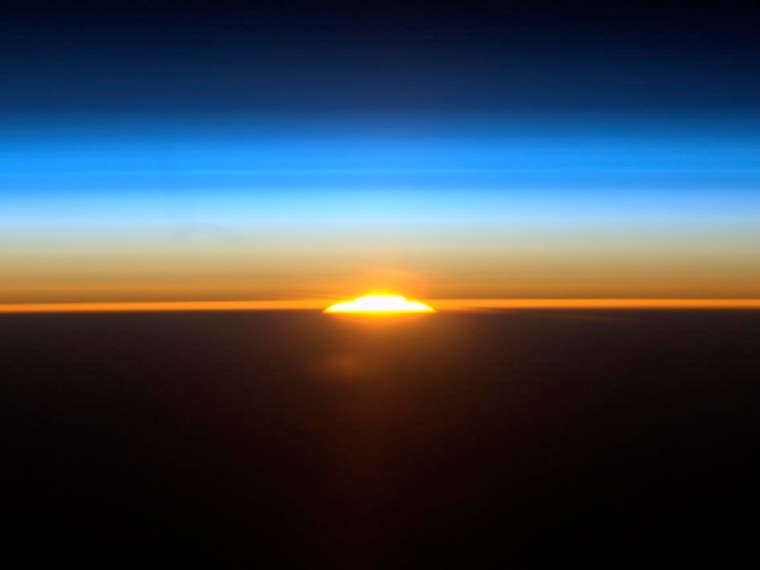 Nickel-eating bacteria may have worsened the mass die-off some 250 million years ago, scientists suggest. (Shown here, International Space Station astronaut Ron Garan's photo of one of the 16 sunrises orbiting astronauts see each day. This was taken on Aug. 27, 2011.)