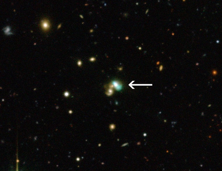 """This view from the Canada-France-Hawaii Telescope shows a close-up of the sky around a very unusual green object called J224024.1-092748 or J2240. It is a bright example of a new class of objects that have been nicknamed """"green bean galaxies."""" This image was released on Wednesday."""