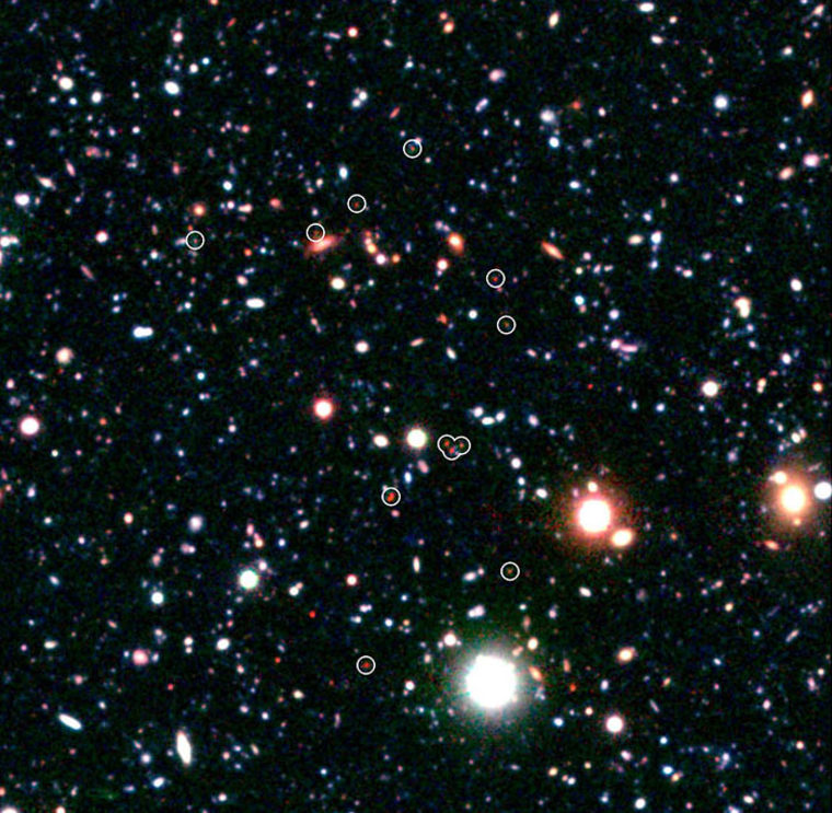 Religion proponents say the universe is too finely tuned for life to not involve a god, while science proponents say we know how the universe formed from nothing. Shown here, a group of galaxies forming very early in the universe, about a billion years after the Big Bang.