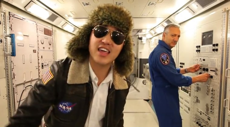"""Astronaut Mike Massimino looks on as a student sings """"NASA Johnson Style"""" in a video published on Friday."""