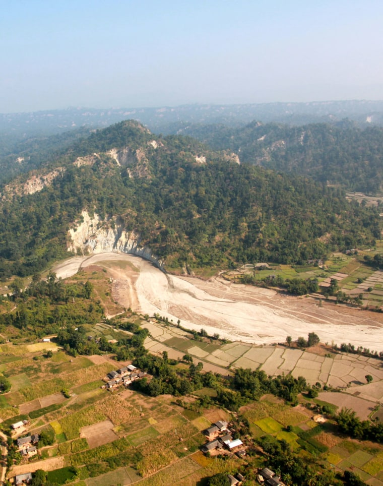 The Sir River alluvial terraces and escarpment along the Main Frontal Thrust. The 1255 and 1934 earthquake scarp follow the sharp contact between the deeply incised Siwalik sandstone folds in the background and inset terraces in the foreground. The rivercut cliff and trench in which the surface breaks of the past earthquakes have been discovered are visible to the right of the river course.