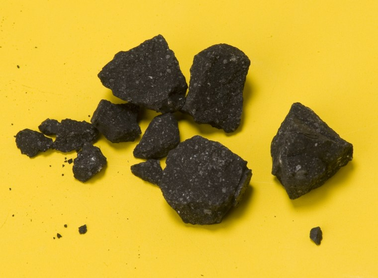A handful of Sutter's Hill meteorite fragments collected on April 24, two days after the fall. Two months later, the scientists reported having 77 meteorite fragments.