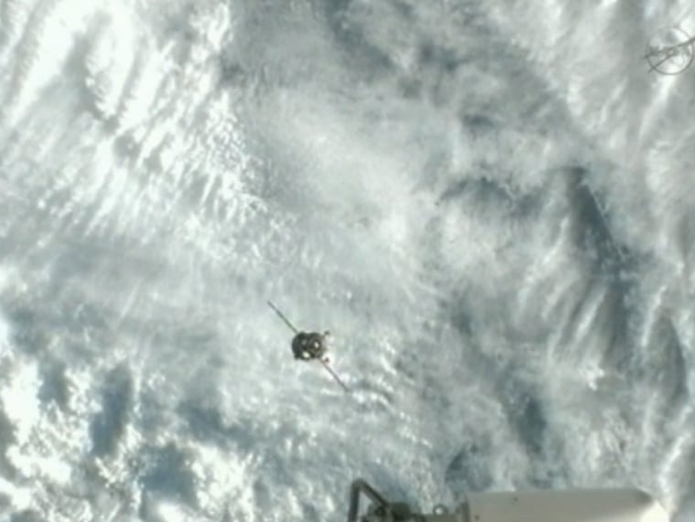 The Soyuz TMA-07M spacecraft approaches the International Space Station for docking on Friday, carrying three new crew members for the Expedition 34 mission.
