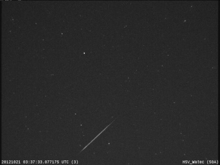 An Orionid meteor streaks across the night sky over Huntsville, Ala., in this view from a camera at NASA's Marshall Space Flight Center before dawn on Oct. 21, during the peak of the Orionid meteor shower.
