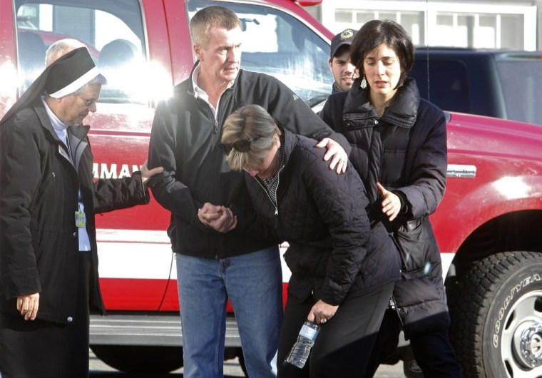 Image: Relatives react outside Sandy Hook Elementary School following a shooting in Newtown