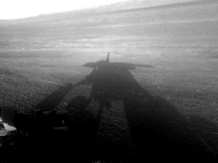NASA's Mars Exploration Rover Opportunity captured this view of its afternoon shadow stretching into Endeavour Crater during the 3,051st Martian day, or sol, of Opportunity's work on Mars on Aug.