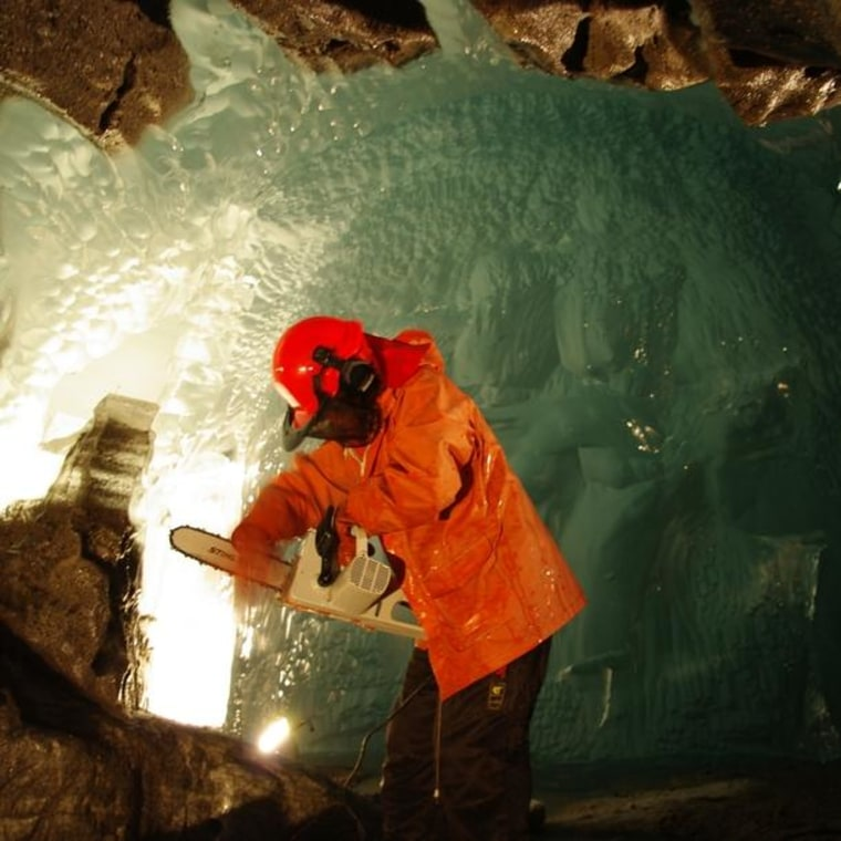 Researcher Miriam Jackson takes ice samples with a chainsaw under Norway's Svartisen glacier.