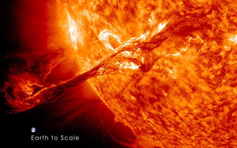 This image shows the Earth to scale with a colossal solar filament eruption from the sun on Aug. 31, 2012 as seen by NASA's Solar Dynamics Observatory spacecraft. Note: the Earth is not this close to the sun, this image is for scale purposes only.