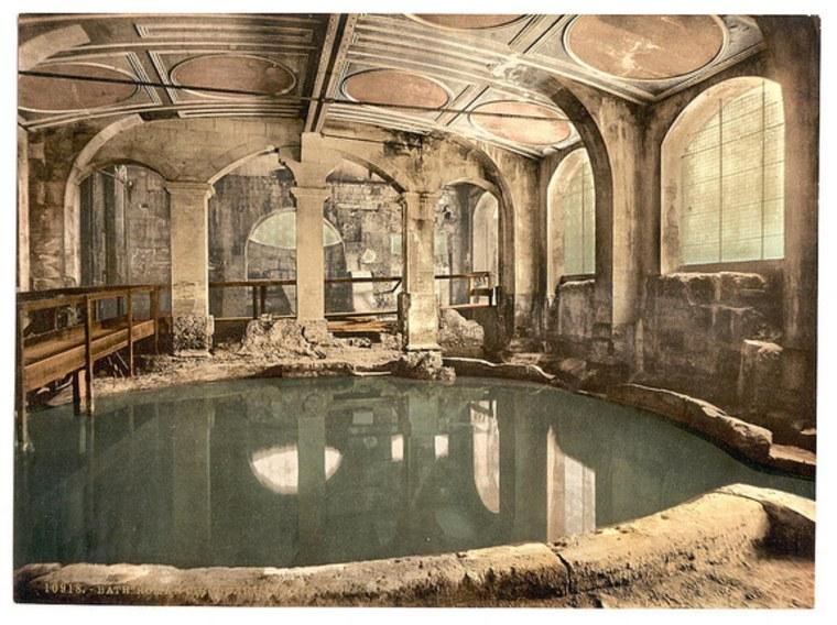 A circular pool in the Roman Baths in Bath, England.