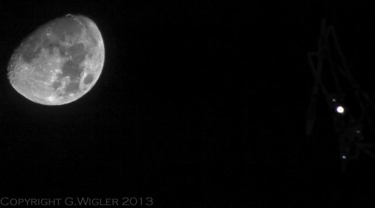 Skywatcher Greg Wigler captured this photo of Jupiter near the moon on Monday during an extreme close encounter. The image also shows two Jovian moons and a star.