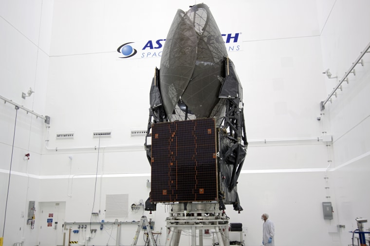 In theAstrotech payload processing facility in Titusville, Fla., near NASA's Kennedy Space Center, a Boeing technician checks out the Tracking and Data Relay Satellite, TDRS-K.