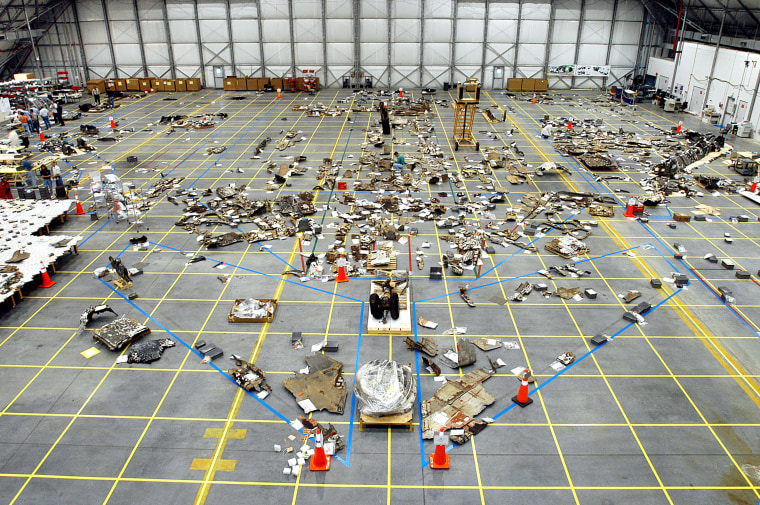 Pieces of Columbia space shuttle debris are seen stored in a hangar at NASA's Kennedy Space Center in Florida during accident investigation in 2003. More than 82,000 pieces of debris from the Feb. 1, 2003 shuttle disaster, which killed seven astronauts, were recovered. In all, 84,800 pounds, or 38 percent of the total dry weight of Columbia, was recovered.
