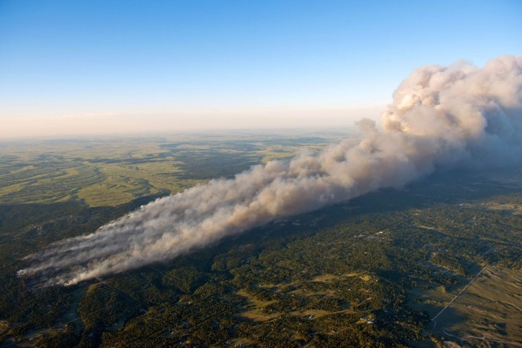 Image: An aerial photo shows wildfire burning homes in Black Forest community near Colorado Springs