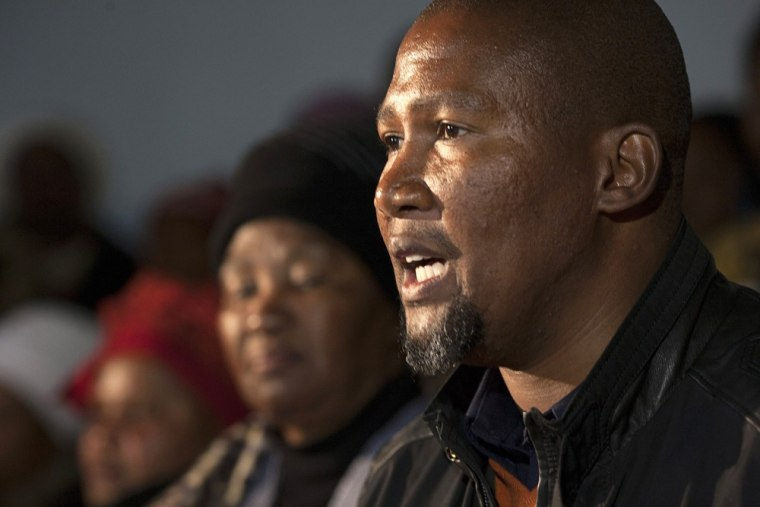 Image: Mandla Mandela, grandson of Nelson Mandela, talks during a news conference in Mvezo, a day after a court order to exhume the remains of three of the anti-apartheid hero's children
