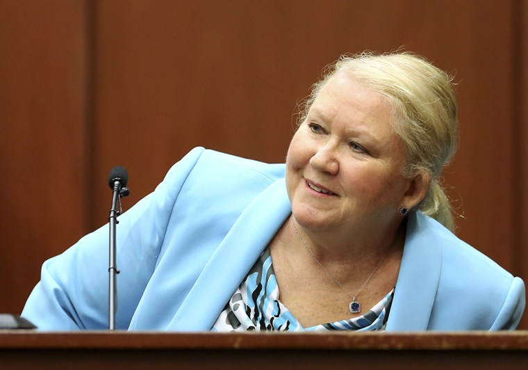 Image: LeAnne Benjamin, a friend of George Zimmerman, smiles while identifying him in court during her testimony in Zimmerman's second-degree murder trial in Sanford, Fla., on July 8.