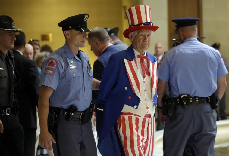 """Image: A man dressed as Uncle Sam is arrested during \""""Moral Monday\"""" demonstrations at the General Assembly in Raleigh."""