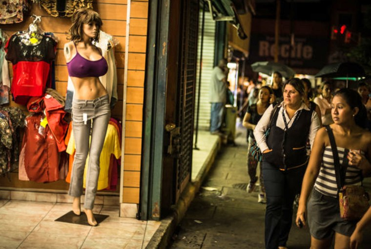 Mannequins with extreme proportions display clothes for sale at a store in Caracas, Venezuela, Oct. 30, 2013.