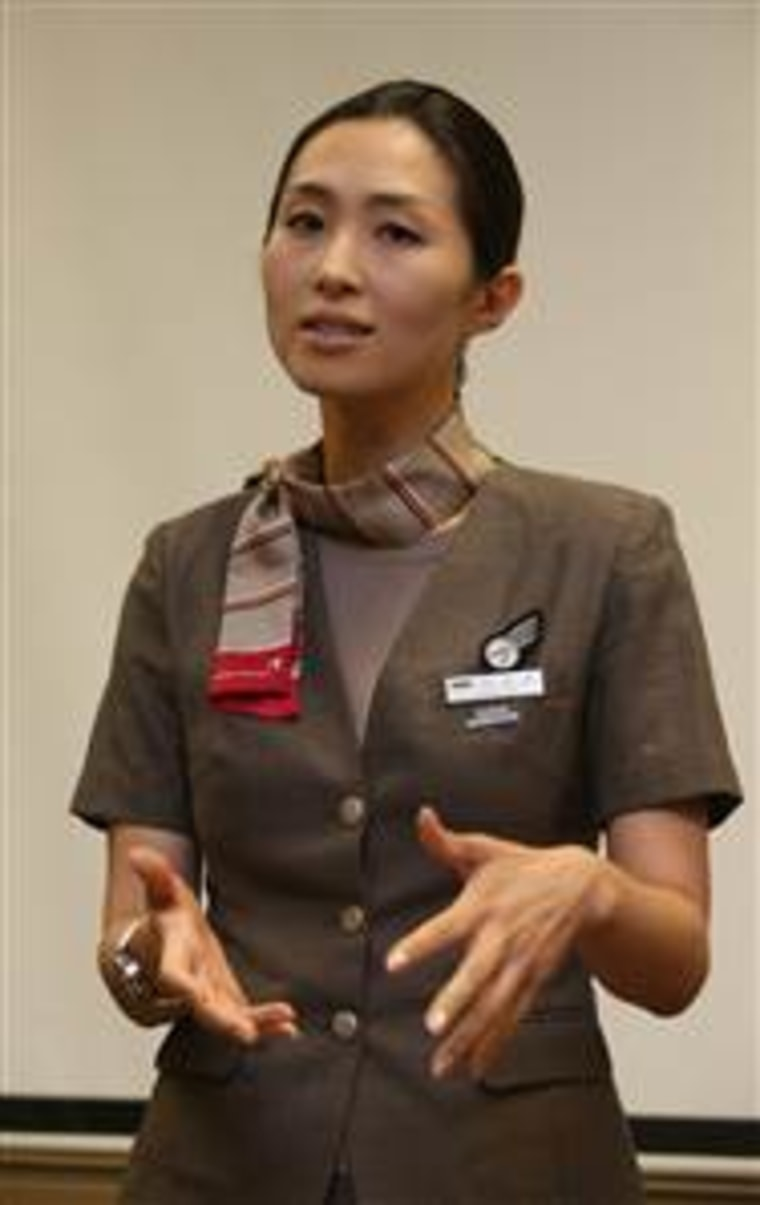Asiana Airlines flight attendant Lee Yoon-hye, a crew member on the plane that crash landed Saturday in San Francisco, discusses the crash at a hotel in San Francisco on Sunday.