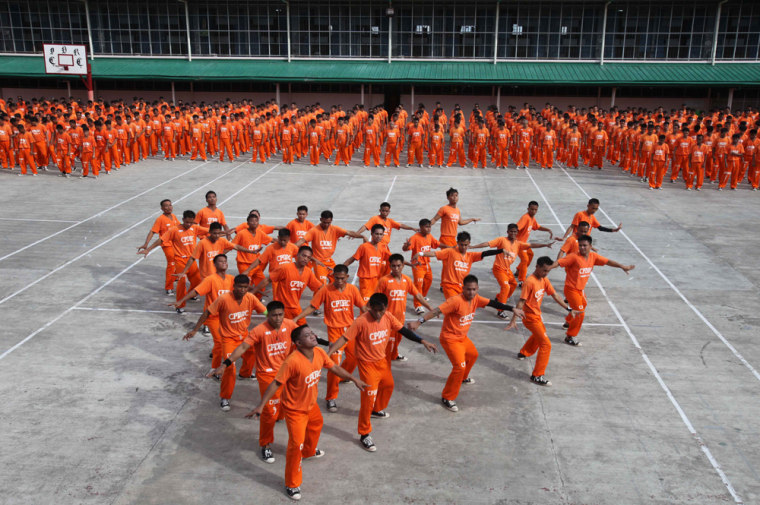 "Image: Inmates at the island province of Cebu in central Philippines dance to the late Michael Jackson's ""Thriller"""