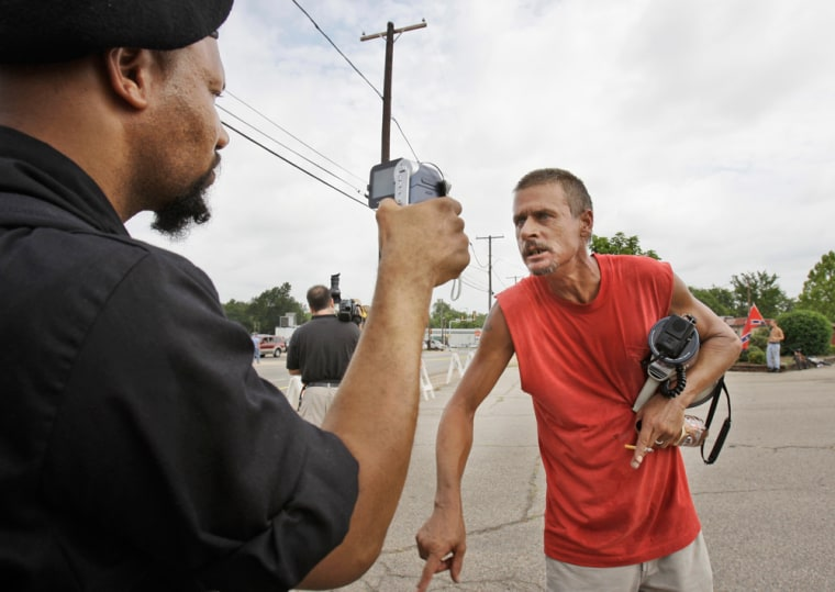 Image: a protest between hundreds of black and white protesters in Paris, Texas