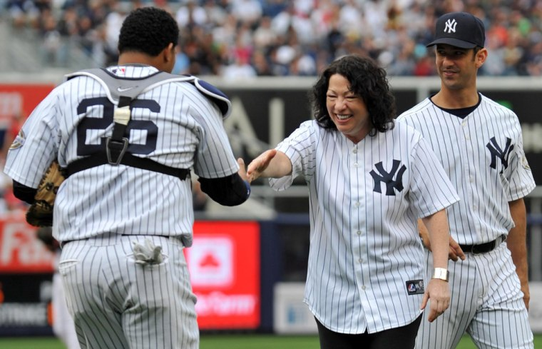 Image: Supreme Court Justice Sonia Sotomayor shakes hands with Yankees' catcher Jose Molina