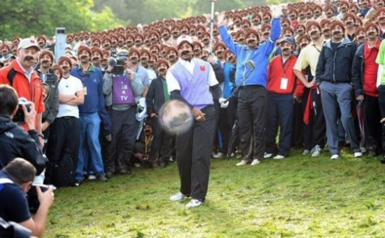 """The """"Cigar Guy"""" takes over the Daily Mail's crazy Tiger Woods Ryder Cup photo in this Photoshop mashup found on the site Reddit."""