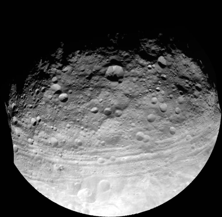 An image taken by NASA's Dawn spacecraft on July 24, 2011, shows troughs along the equator of the asteroid Vesta, including Divalia Fossa, which is larger than the Grand Canyon. A new study analyzing these troughs finds that they are probably graben – a dip in the surface with faults on either side that would indicate that Vesta has characteristics much like a planet
