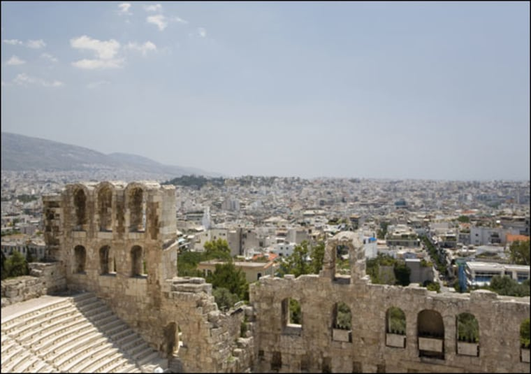 Getty Images |   Athens Today A photo of Athens and the Acropolis. In ancient Greece, homes often doubled as brothels and drinking establishments, suggests new archaeological research.