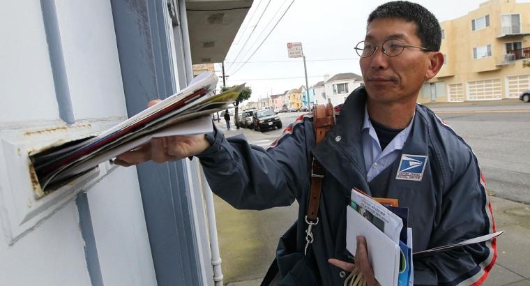 Postal worker delivers mail (Justin Sullivan/Getty Images)