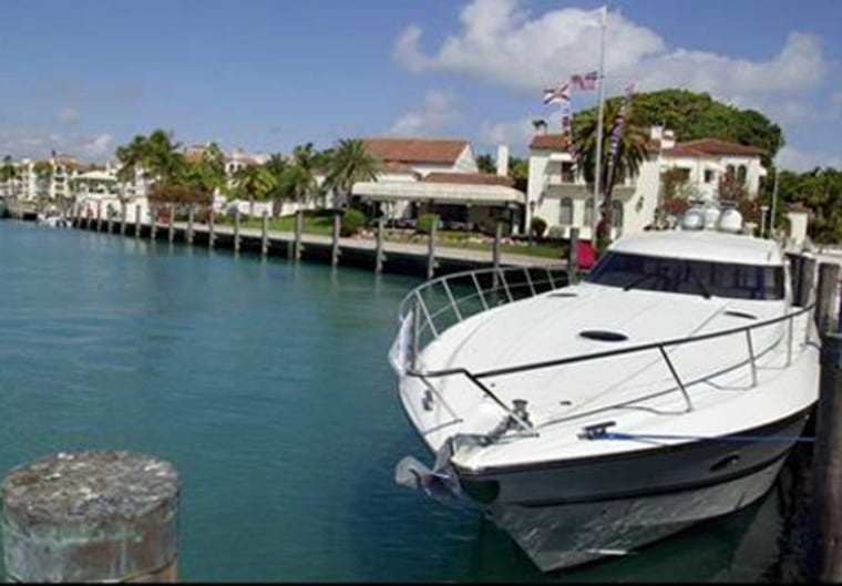 A yacht sits tied up in a slip by the Vanderbilt Mansion on Fisher Island, an exclusive golf, tennis and spa community located in South Florida. The average net worth for taxpayers here with at least $200,000 of income is $57.2 million, Forbes estimates.