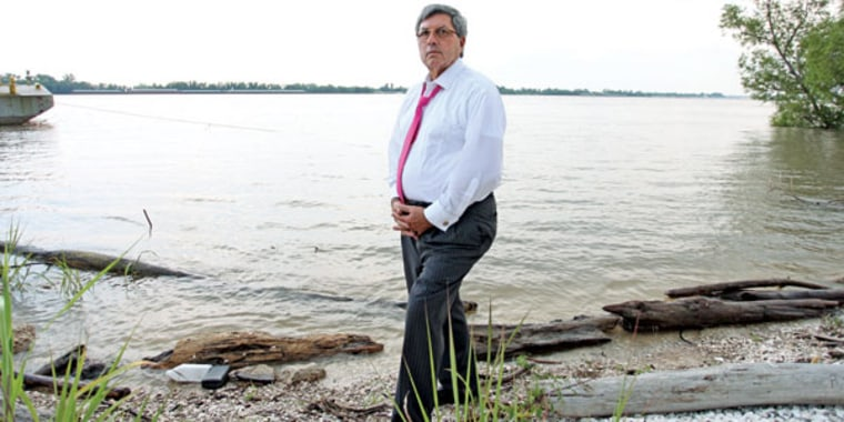 Daniel Becnel Jr. on the banks of the Mississippi River near his hometown of Garyville, La.