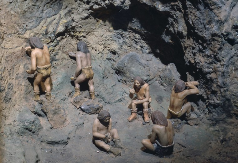 This diaroma shows what a crew of cavemen painters may have looked like. Both of the caves examined in this study feature art on the walls, some of which shows cave bears.