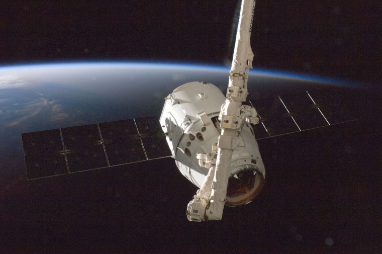 The SpaceX Dragon commercial cargo craft is grappled by the International Space Station's Canadarm2 robotic arm on Oct. 10, 2012 during the spacecraft's first cargo delivery mission for NASA under a $1.6 billion deal for commercial cargo delivery.