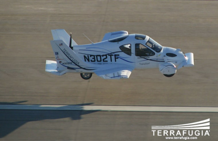 Terrafugia |   Airborne Terrafugia's Transition part-car, part-airplane took its first test flight, lasting 37 seconds. The vehicle took off and landed successfully.