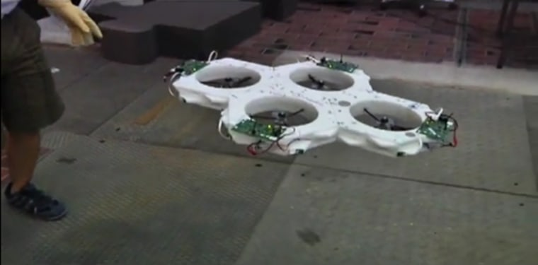 Four hexagonal robots, each with a propeller at its center, hook up using magnets to create one stable flying machine.