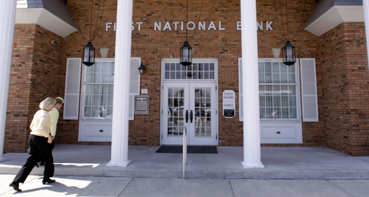 Image: People enter First National Bank in Staunton, Ill.